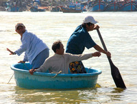 Nha Trang, Men in Round Boat0952326a